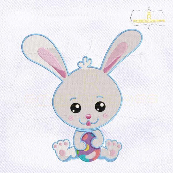Easter Rabbit Holding Egg Embroidery Design